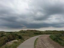 Облака над дюнами Стоковая Фотография