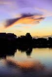 Облака отраженные на воде Стоковые Изображения