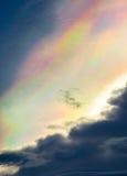 Облака радуги и небо захода солнца используемое как предпосылка Стоковая Фотография RF