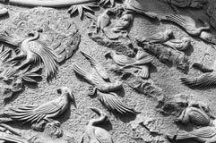 Облицуйте carvings стоковое изображение