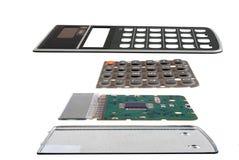 Обломок калькулятора установленный на интегральную схемау, изолированную на белой предпосылке Стоковая Фотография RF