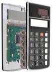 Обломок калькулятора установленный на интегральную схемау, изолированную на белой предпосылке Стоковое фото RF
