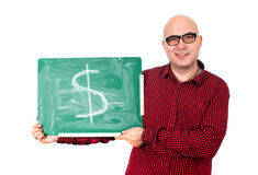 Человек с знаком доллара на доске Стоковые Фото