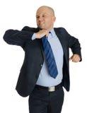 Облыселый человек с костюмом и белая предпосылка с связи Стоковые Фото