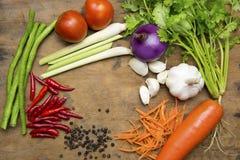 Овощи в таблице и ложке Стоковые Фотографии RF