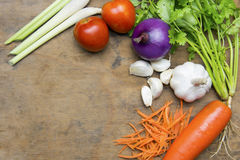 Овощи в таблице и ложке Стоковое Фото
