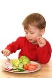 овощи мальчика Стоковое фото RF