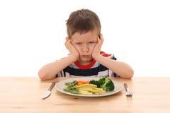 овощи мальчика стоковая фотография rf