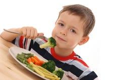 овощи мальчика стоковые изображения