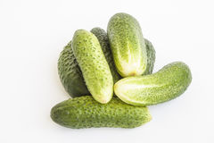 Овощи Огурцы зеленого цвета на белой предпосылке Стоковые Изображения