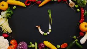 Овощи сделали письмо j стоковые фотографии rf