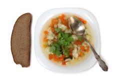 Овощной суп на предпосылке плиты Стоковое фото RF
