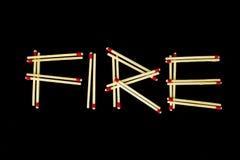 ` Огня ` сказанное по буквам с спичками Стоковое Изображение