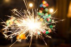 Огонь Бенгалии на предпосылке рождественской елки Стоковая Фотография