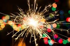 Огонь Бенгалии на предпосылке рождественской елки Стоковые Фото