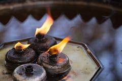 Огонь Будды от свечей фонарика масла Стоковое Изображение RF