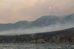 Огонь и дым вокруг Lake Baikal, Сибиря, России Стоковые Фото
