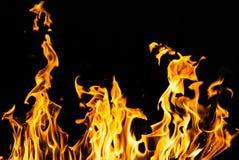 Огонь пламени на черной предпосылке Стоковые Фото