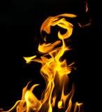 Огонь пламени на черной предпосылке Стоковые Изображения