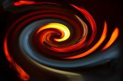 Огонь покрашенный спиралью на черной предпосылке Стоковые Фото