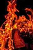 Огонь пламени на черной предпосылке Стоковое Изображение