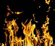 Огонь пламени на черной предпосылке Стоковая Фотография RF