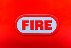 Огонь слова на красном конце-вверх предпосылки стоковое изображение