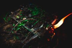 Огонь уловленный материнской платой Стоковое Изображение