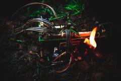 Огонь уловленный материнской платой Стоковые Изображения RF