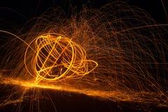 Огонь Poi/закручивая стальная шерсть Стоковые Изображения