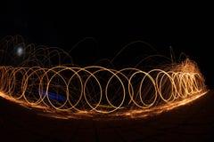 Огонь Poi/закручивая стальная шерсть Стоковые Фото