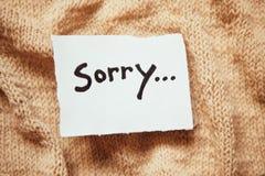 Огорченное слово на белой бумаге с винтажной предпосылкой стоковая фотография rf