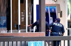 Ограбление банка полиции стоковые изображения