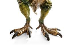 Огромные ноги тиранозавра, игрушки динозавров Стоковое Фото