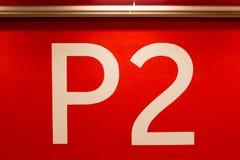 Огромный знак P2 покрашенный на красной стене Стоковое Изображение RF