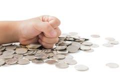 Огромный успех руки на изолированной монетке Стоковое Изображение RF