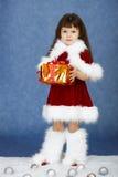 одевает девушку подарка шерсти меньший новый год s Стоковые Изображения RF