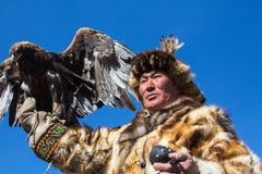 Одежда охотника орла казаха традиционная Стоковые Изображения RF