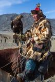 Одежда охотника орла казаха традиционная Стоковые Фотографии RF