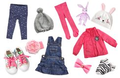 Одежда ` s девушки ребенка изолированная на белизне Стоковое Фото