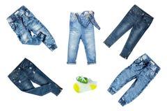 Одежды джинсов собрания на белой предпосылке Собрание сини стоковые фото
