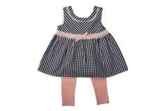 Одежды для детей, dres черно-белых checkered ребёнка стоковые изображения