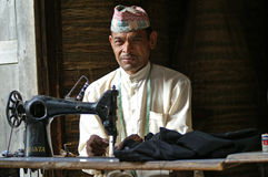 одежды подвергают шить механической обработке шьют taylor Стоковые Изображения