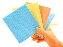 Одежды чистки в руке в защитной перчатке Стоковое Изображение