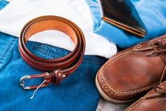 Одежды ` s человека и кожаные аксессуары Стоковая Фотография