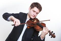Одетый человек человека элегантно играющ скрипку Стоковое фото RF