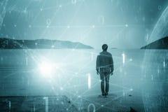 Одиночный человек с футуристической сетью двоичных чисел Стоковые Фото