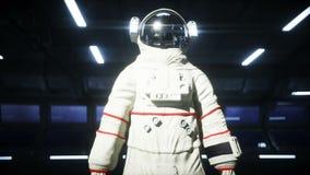 Один астронавт в футуристическом коридоре космоса, комнате взгляд земли кинематографический отснятый видеоматериал 4k иллюстрация штока