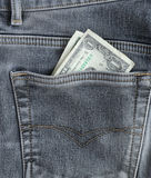 Один доллар кредитки в карманн. Стоковое Изображение RF