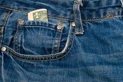 Один доллар счета в карманн Стоковая Фотография